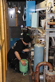 a refrigeration technician at work