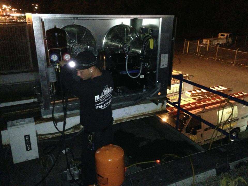 cooling technicians install a rooftop unit