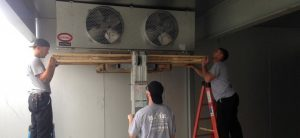 m. j. mac team installs an ac unit